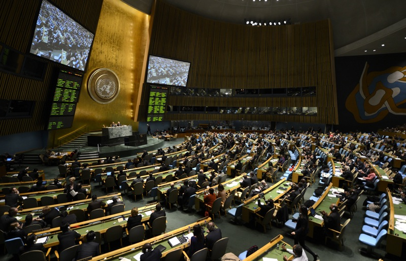 Delegates to the United Nations General Assembly April 2, 2013 after passing the first UN treaty regulating the international arms trade. The UN General Assembly on Tuesday adopted the first-ever treaty to regulate the $80-billion-a-year conventional arms trade. The assembly voted 154-3 for a resolution that will open the treaty for signature from June. Syria, North Korea and Iran -- which had blocked the treaty last week -- voted against it. Russia was among the 23 abstentions. AFP PHOTO / TIMOTHY A. CLARY        (Photo credit should read TIMOTHY A. CLARY/AFP/Getty Images)