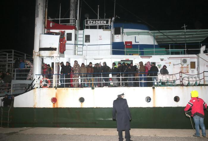 The cargo ship Ezadeen, carrying hundreds of migrants, arrives at the southern Italian port of Corigliano, Italy, late Friday, Jan. 2, 2015. The cargo ship was stopped with about 450 migrants aboard after smugglers sent it speeding toward the coast in rough seas with no one in command. Italian authorities lowered engineers and electricians onto the wave-tossed ship by helicopter to secure it, and the Icelandic Coast Guard towed it to the Italian port of Corigliano late Friday night. Smugglers who bring migrants to Europe by sea appear to have adopted a new, more dangerous tactic: cramming hundreds of them onto a large cargo ship, setting it on an automated course to crash into the coast, and then abandoning the helm. (AP Photo/Antonino D'Urso) [Credit: ANSA]