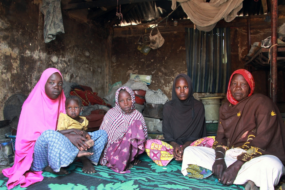 L-R  Kaltuma, 25, her daughter Aisha, 3, her sister Fatima, 10, her sister Aisha, 20, with her son Baba Ali, ten months old and mother of the family Hauwa Abba, 55. The Abba family fled their home in Abadan, near the border with Niger, two years ago following an attack. They have been living in a camp on the outskirts of Maiduguri since then. They were one of 500 families to receive food from MSF on December 14, 2016.