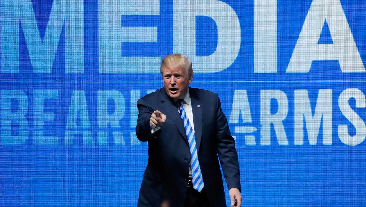 FILE PHOTO: U.S. President Donald Trump gestures after speaking at a National Rifle Association (NRA) convention in Dallas, Texas, U.S. May 4, 2018. REUTERS/Lucas Jackson/File Photo
