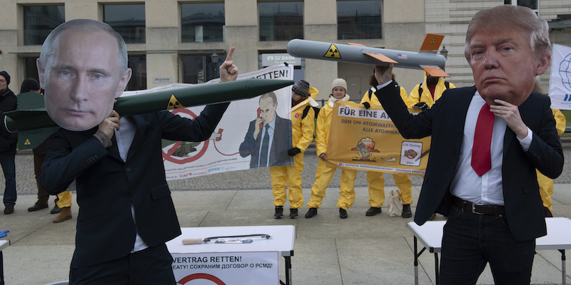 01 February 2019, Berlin: Demonstrators with a Putin and Trump mask face each other with rocket models on Pariser Platz. They are protesting with their action against the imminent end of the INF disarmament agreement between Russia and the USA. The agreement on Intermediate Range Nuclear Forces is to be dissolved by the USA. Photo by: Paul Zinken/picture-alliance/dpa/AP Images