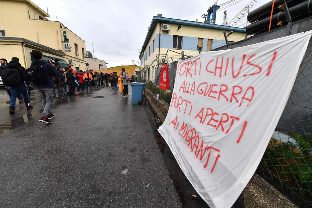 Pacifists during the protest against the Saudi cargo ship Bahri Yanbu docked in the port of Genoa on 20 May 2019.The cargo ship flying the flag of Saudi Arabia loaded with weapons Bahri Yambu is docked this morning around 6 am at the GMT terminal of the port of Genoa. ANSA/LUCA ZENNARO