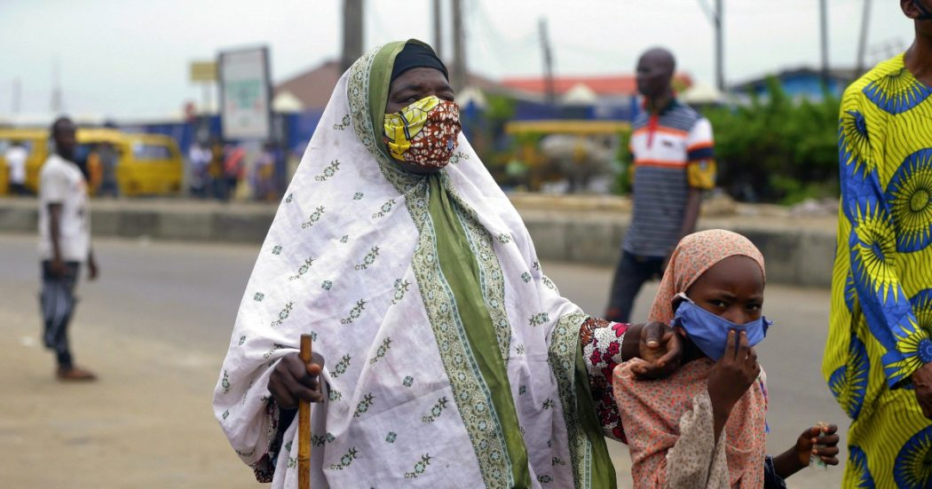 A beggar wearing a face mask walks on the street Lagos Nigeria, Monday May 4, 2020. Though Nigeria begun a phased easing of its strict lockdown measures on Monday, its confirmed cases of coronavirus continue to increase. (AP Photo/Sunday Alamba)